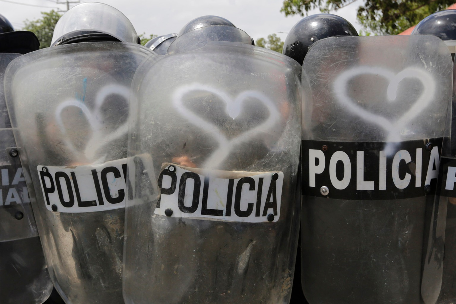 Riot police hold shields with graffiti made by activists during clashes within a protest against Nicaraguan President Daniel Ortega's government in Managua on Sept. 23. INTI OCON/AFP/Getty Images