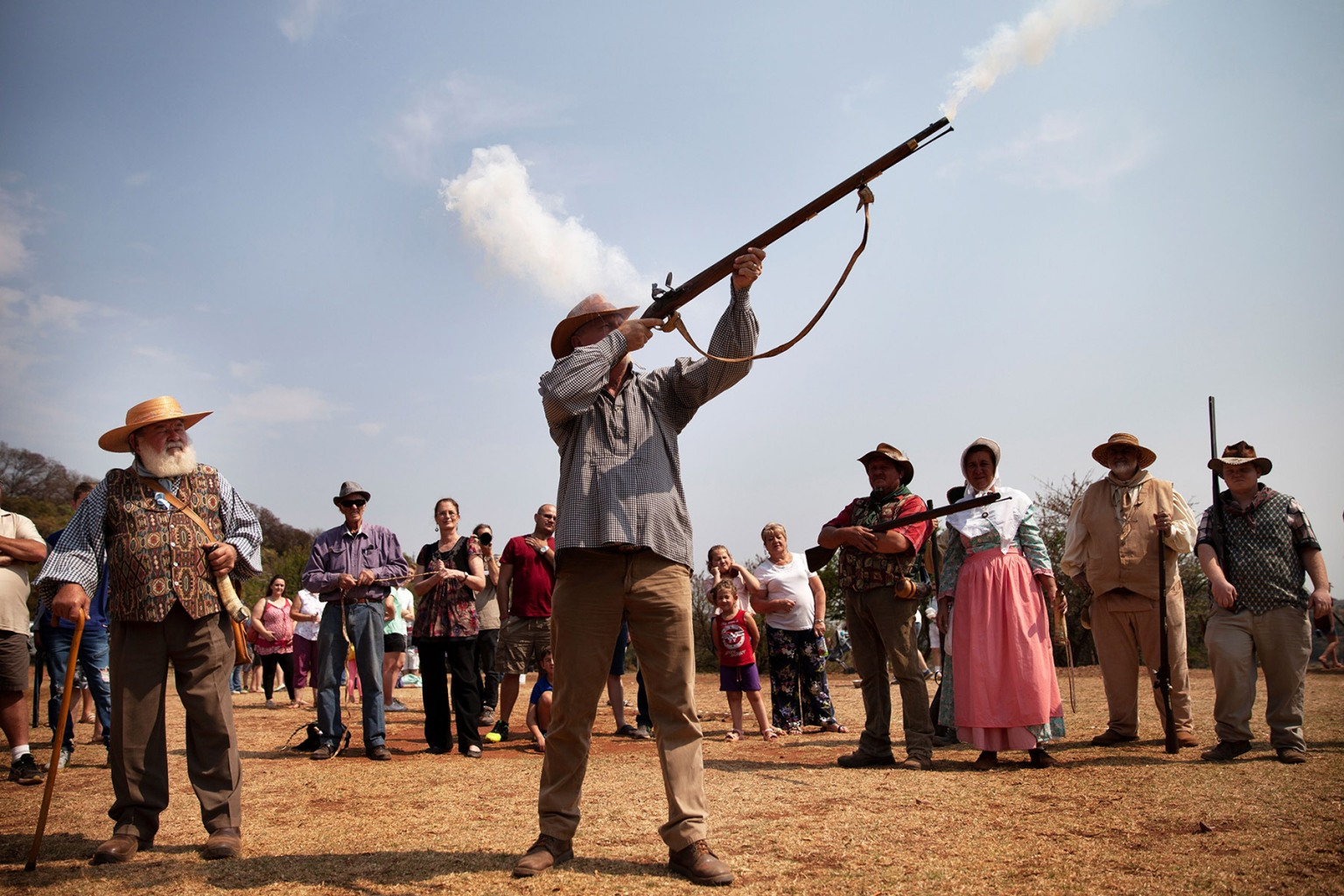 A man dressed in traditional Voortrekker attire fires a Flintlock gun at the Voortrekker Monument on Heritage Day in Pretoria on Sept. 24. FLORIAN CHOBLET/AFP/Getty Images