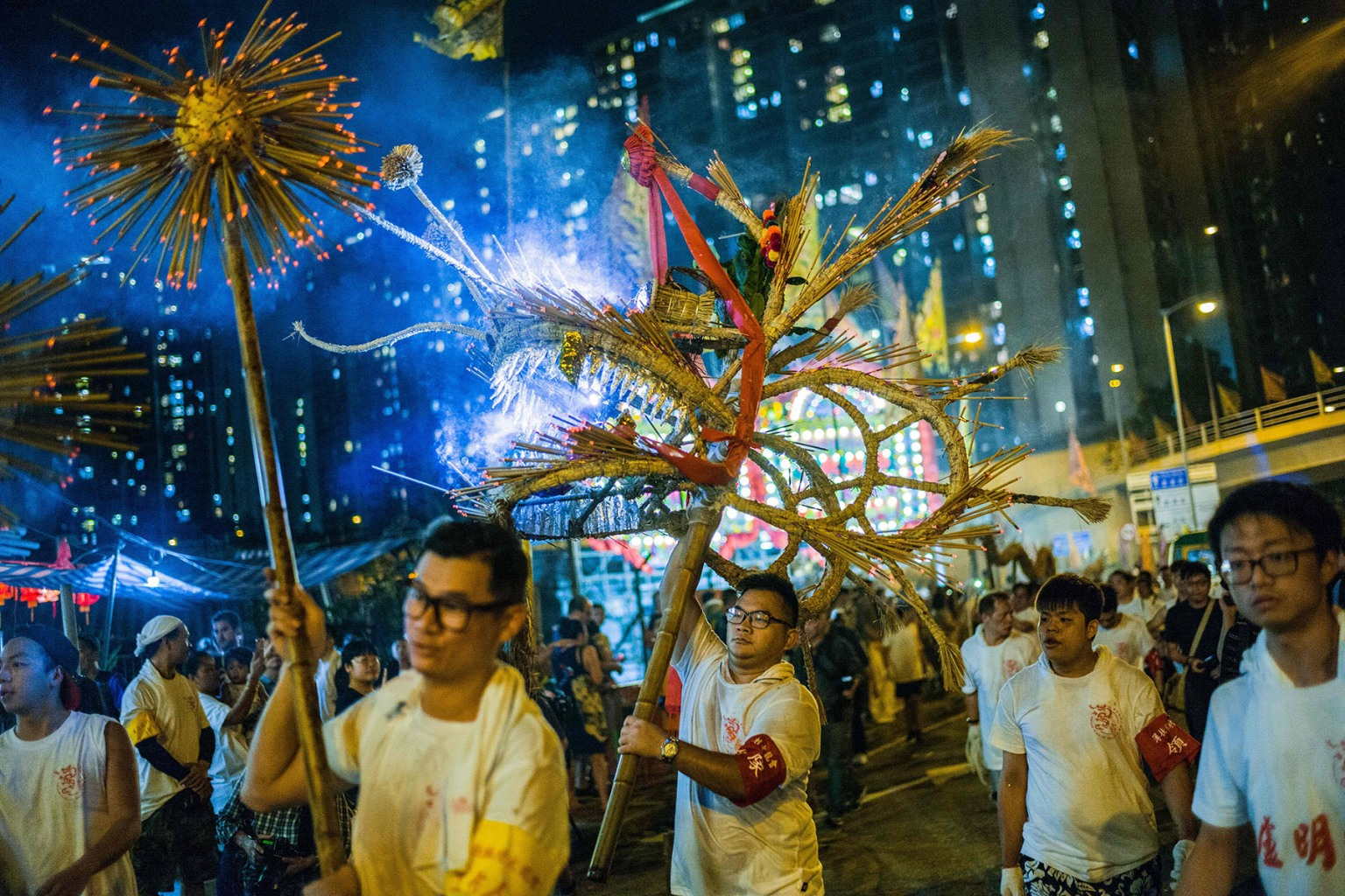 Performers carry an ornate straw-stuffed dragon stuck with hundreds of incense sticks as part of a mid-autumn festival celebration in Pok Fu Lam village in Hong Kong on Sept. 24. ANTHONY WALLACE/AFP/Getty Images