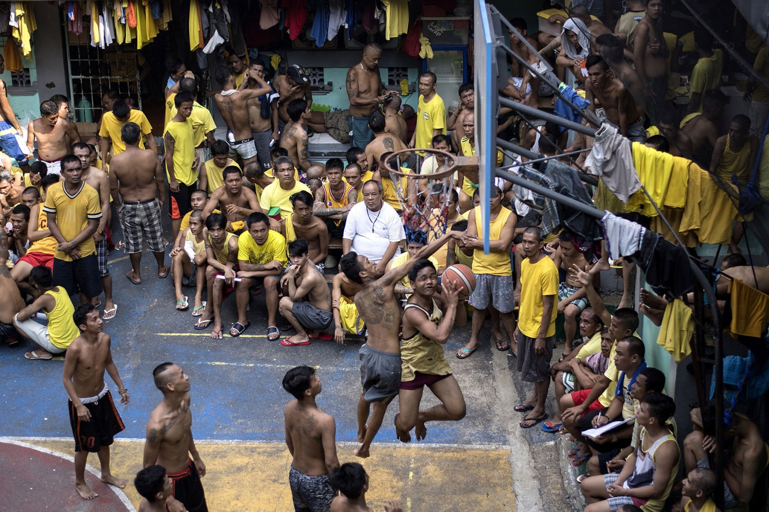 Inmates play basketball in the Quezon City jail in suburban Manila on Sept. 25. NOEL CELIS/AFP/Getty Images