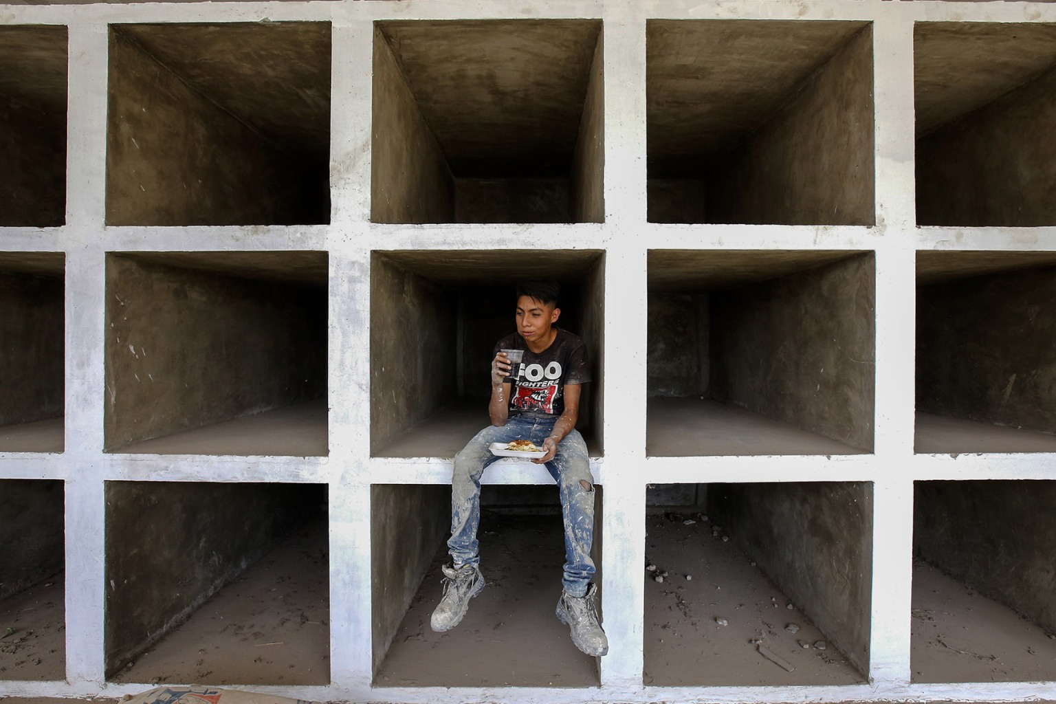 A man rests as crypts are adapted for hundreds of unidentified bodies at the municipal pantheon in El Salto, Jalisco State, Mexico, on Sept. 25. - Dozens of Mexicans searching for missing relatives amid a wave of violence linked to powerful drug cartels traveled to Guadalajara, where a scandal has erupted over a truck full of unidentified bodies that overflowed local morgues. ULISES RUIZ/AFP/Getty Images