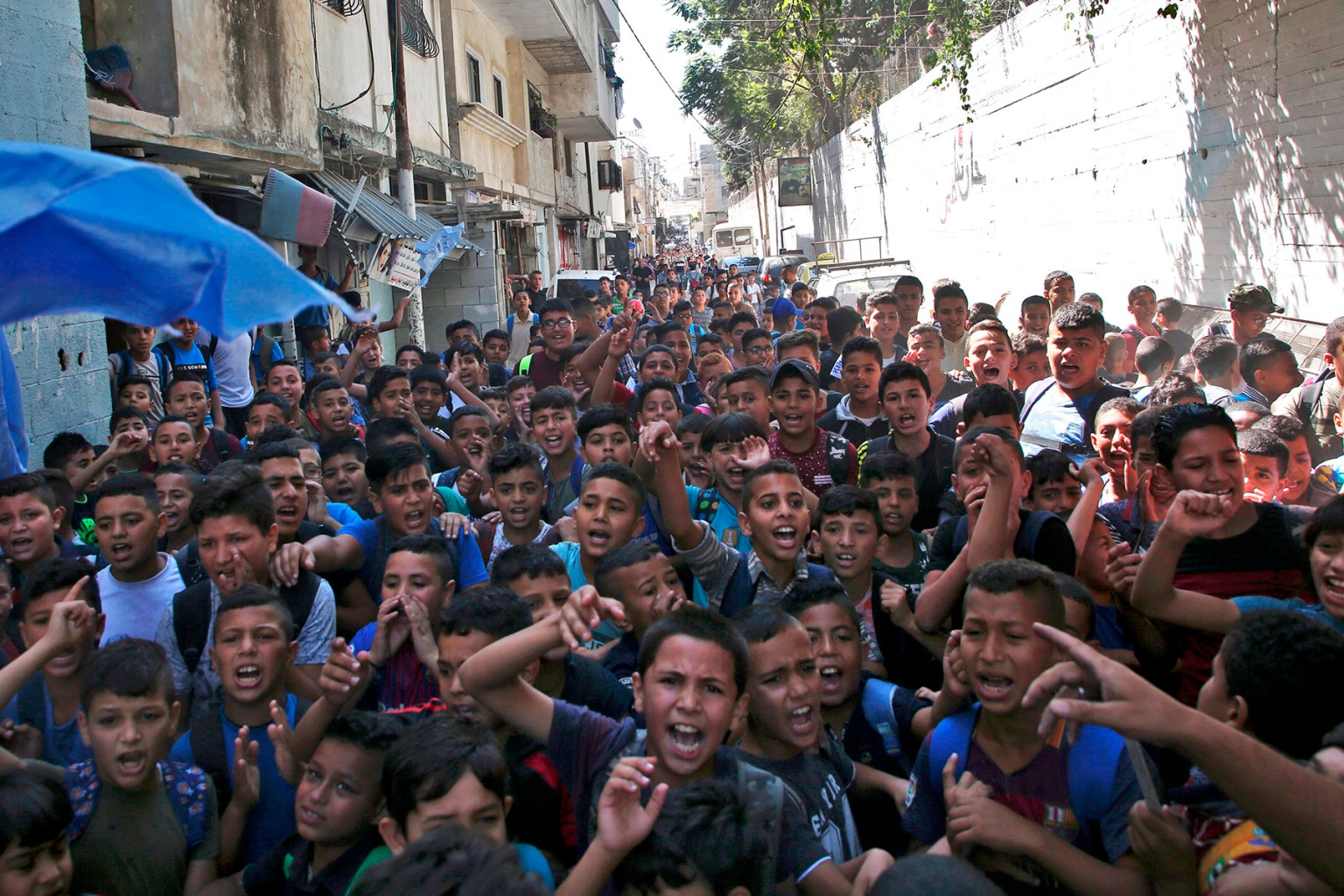 Palestinian students protest in front of a school administered by the United Nations Relief and Works Agency and financed by U.S. aid, in the Balata refugee camp near Nablus in the occupied West Bank, on Sept. 25. Earlier this year, the United States, by far the biggest contributor to UNRWA, announced it was halting funding to the agency. JAAFAR ASHTIYEH/AFP/Getty Images)