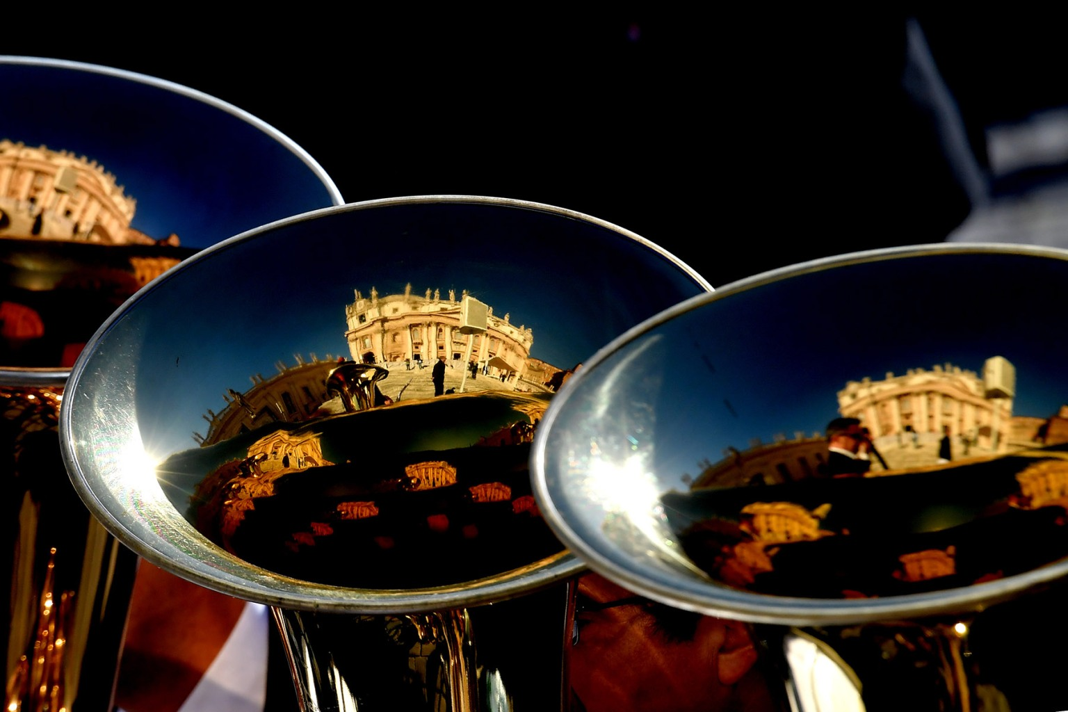 The basilica of St.Peter's is reflected in musical instruments during the pope's weekly general audience at the Vatican on Sept. 26. TIZIANA FABI/AFP/Getty Images