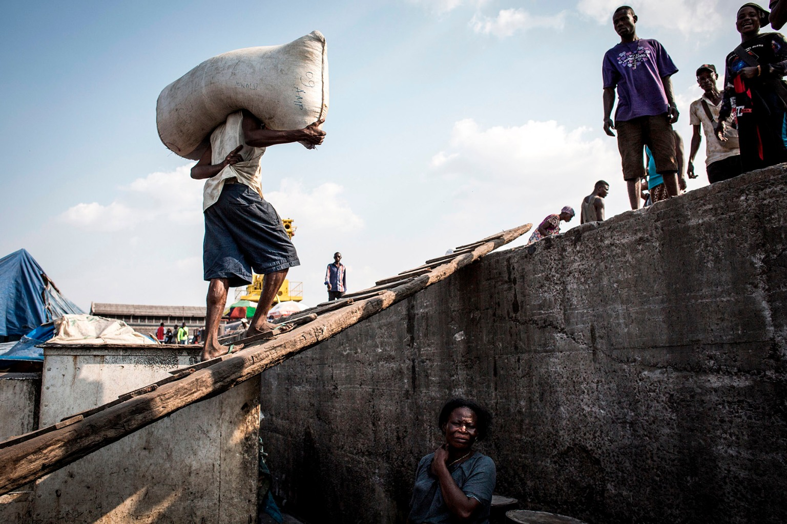 A Congolese man carries a sack in Kinshasa, a port along the Congo River, on Sept. 25. JOHN WESSELS/AFP/Getty Images