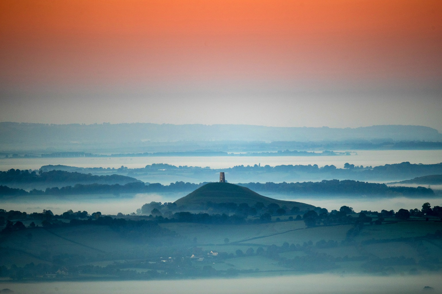 Early morning mist lingers below Glastonbury Tor as the sun rises in Somerset, England, on Sept. 27. Matt Cardy/Getty Images
