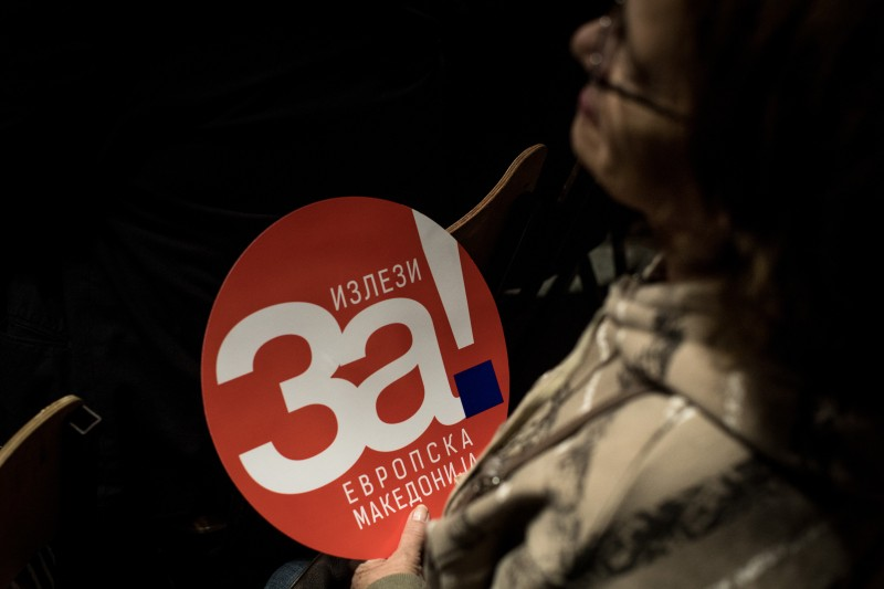 "A woman holds a ""Yes"" poster during a rally in Tetovo, Macedonia, on Sept. 27, before this weekend's referendum on changing Macedonia's name. (Chris McGrath/Getty Images)"