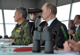 Russian President Vladimir Putin (R) and Defense Minister Sergei Shoigu inspect Russian Army's and Naval military exercises in Pacific Ocean not far from the isle of Sakhalin, also claimed by Japan,  on July 16, 2013.  (ALEXEI NIKOLSKY/AFP/Getty Images)