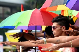 Indian activists take an oath to fight together for the repeal of Section 377 in Bangalore on July 2, 2014. (Manjunath Kiran/AFP/Getty Images)