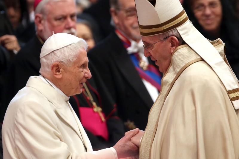 Pope Emeritus Benedict XVI is greeted by Pope Francis during the Ordinary Public Consistory at St. Peter's Basilica on February 14, 2015 in Vatican City, Vatican. (Franco Origlia/Getty Images)