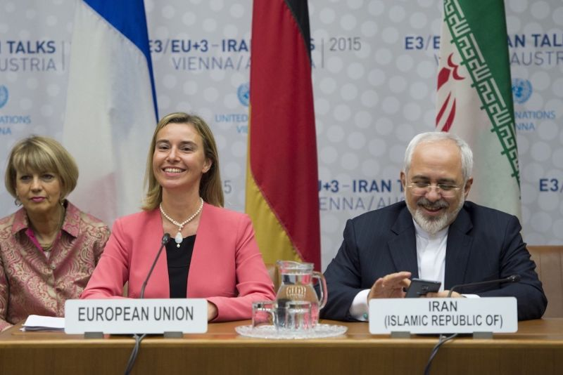 Iranian Foreign Minister Mohammad Javad Zarif speaks next to European Union High Representative for Foreign Affairs and Security Policy Federica Mogherini during a plenary session at the United Nations building in Vienna, Austria on July 14, 2015. (Joe Klamar/AFP/Getty Images)