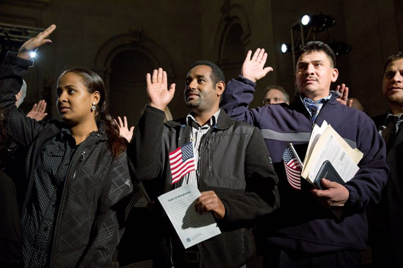 Naturalization candidates attend a ceremony for new U.S. citizens at the National Archives in Washington on Dec. 15, 2015. (Martin H. Simon/Pool/Getty Images)