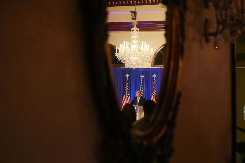 Republican presidential candidate Donald Trump is reflected in a mirror during a press conference in West Palm Beach on March 5, 2016. (Joe Raedle/Getty Images)