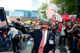 A man dressed as Pinocchio holds a sign during a protest march against the US president and the Belgian Prime Minister in the city center of Brussels on May 24, 2017. (BRUNO FAHY/AFP/Getty Images)