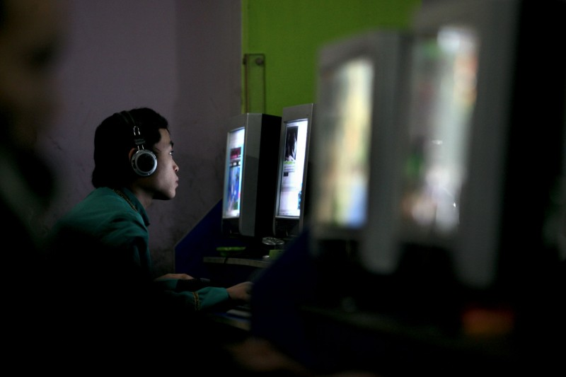A computer user in a net cafe in Chongqing Municipality on January 21, 2008. (China Photos/Getty Images)