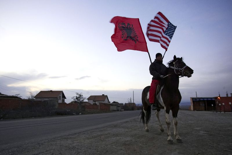 Kosovo-Albanian waves an Albanian and a American flag when he ride a horse during the celebration of Kosovo's expected declaration of independence on February 16, 2008 in  Pristina, Kosov. (Carsten Koall/Getty Images)