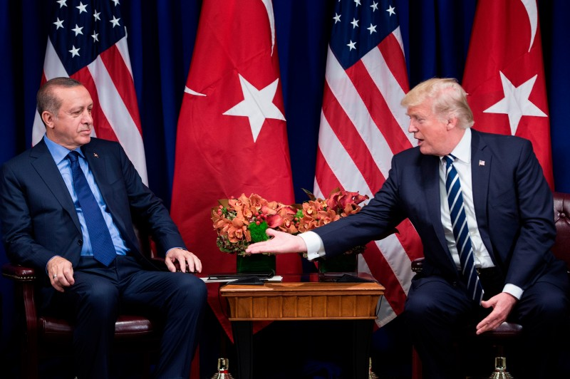 U.S. President Donald Trump reaches to shake Turkish President Recep Tayyip Erdogan's hand before a meeting at the Palace Hotel during the 72nd U.N. General Assembly on Sept. 21, 2017 in New York City. (Brendan Smialowski/AFP/Getty Images)