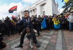 Activists protest during an anti-corruption rally in front of the Ukrainian parliament in Kiev on Oct. 22, 2017. (SERGEI SUPINSKY/AFP/Getty Images)
