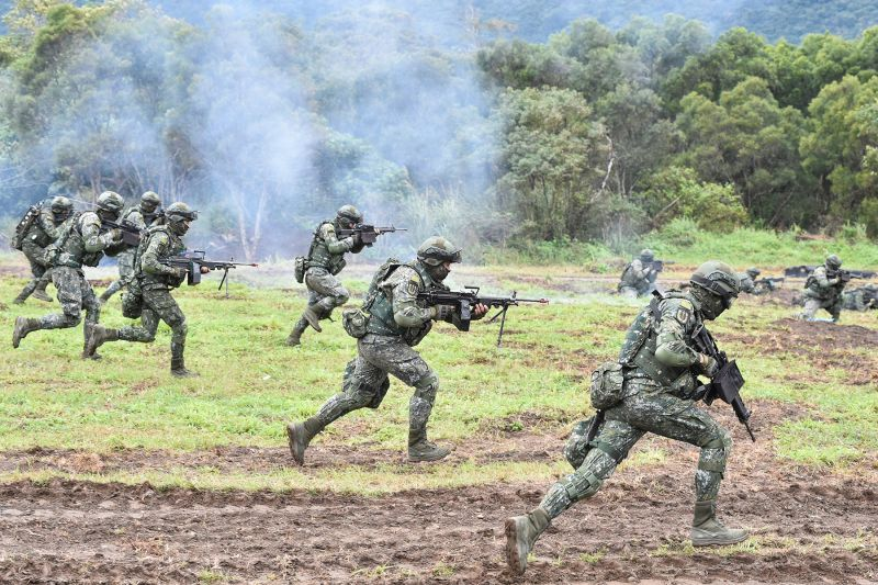 Taiwanese soldiers simulate fending off an attempted invasion during an annual drill at the military base in Hualien on Jan. 30. (Mandy Cheng/AFP/Getty Images)