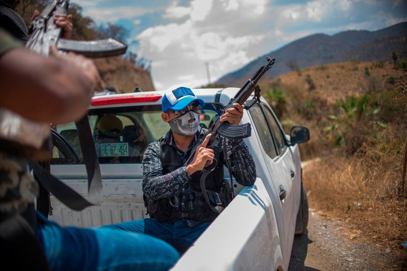 Community police patrol the hills in Carrizalillo, Guerrero state, one of Mexico's most dangerous, crime-ridden regions, on March 24. (Pedro Pardo/AFP/Getty Images)