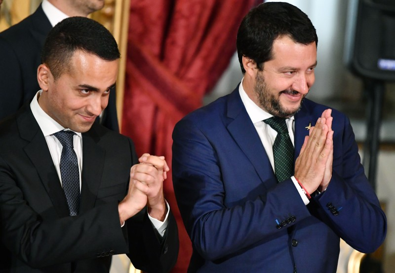 Italys Interior Minister and deputy PM Matteo Salvini (R) and Italys Labor and Industry Minister and deputy PM Luigi Di Maio gesture during the swearing in ceremony of the new government led by Prime Minister Giuseppe Conte at Quirinale Palace in Rome on June 1, 2018. (ALBERTO PIZZOLI/AFP/Getty Images)