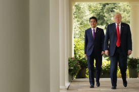 Japanese Prime Minister Shinzo Abe and U.S. President Donald Trump walk along the Rose Garden colonnade as they arrive for a joint news conference at the White House, June 7, 2018 (Chip Somodevilla/Getty Images)
