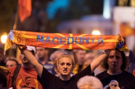 A demonstrator holds a banner in front of the parliament building in Skopje on June 13, 2018 during a protest against an agreement with Greece to change Macedonia's name. (Robert Atanasovski/AFP/Getty Images)