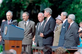 U.S. President Bill Clinton, center, prepares to give the opening address of the historic Israel-PLO Oslo Accords signing ceremony on Sept. 13, 1993 at the White House with Israeli Prime Minister Yitzhak Rabin and PLO Chairman Yasser Arafat at his side. (Luke Frazza/AFP/Getty Images)