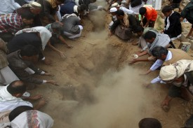 Yemeni mourners bury the bodies of Houthis killed in a car bomb attack which targeted a Shiite Muslim mosque in Sanaa during a group funeral procession in the Yemeni capital on July 22, 2015.