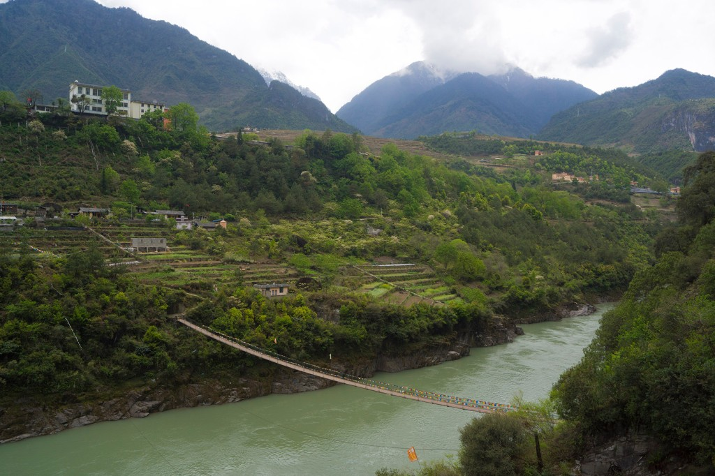 A footbridge over the Nujiang River near Bingzhongluo, in Nujiang prefecture, China, on April 10. The bridge links the increasingly modern village of Bingzhongluo with a group of subsistence agricultural communities found at higher altitudes. (Edward Cavanough for Foreign Policy)