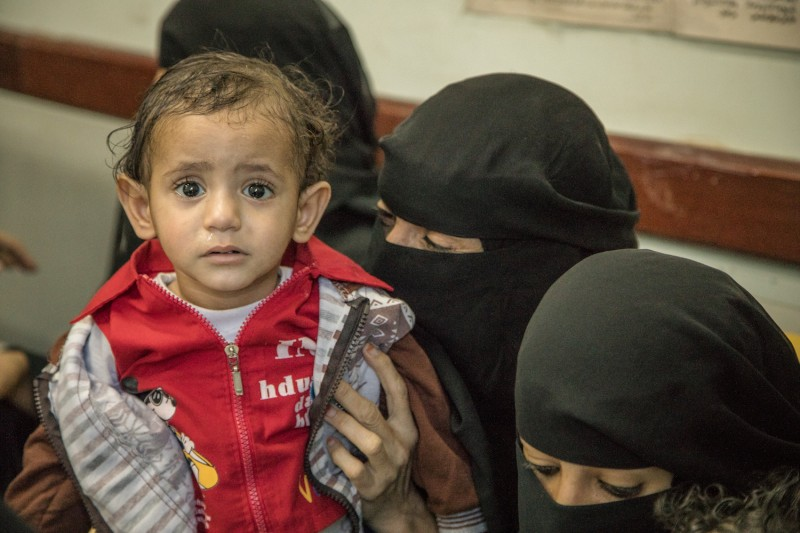 Families wait for care at a health center in Yemen in September. (Courtesy International Rescue Committee)