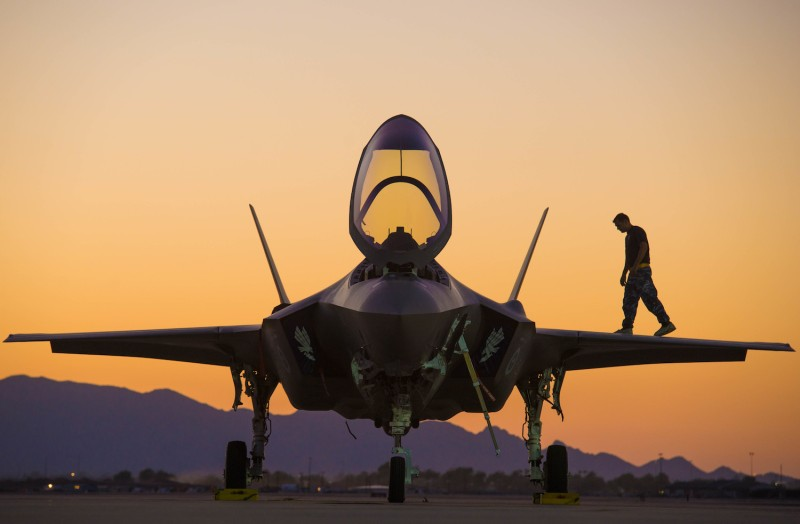A Royal Australian Air Force airman walks on the wing of an F-35A Lightning II at Luke Air Force Base in Arizona on Aug. 6. (U.S. Air Force photo by Staff Sgt. Jensen Stidham)
