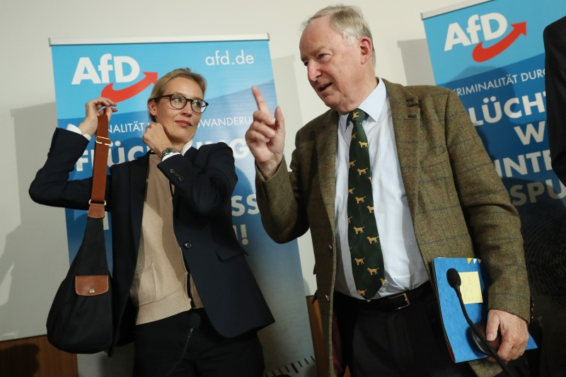 Alice Weidel and Alexander Gauland, co-leaders of the Alternative for Germany (AfD) party, arrive to speak on immigration and crime on September 18, 2017 in Berlin.