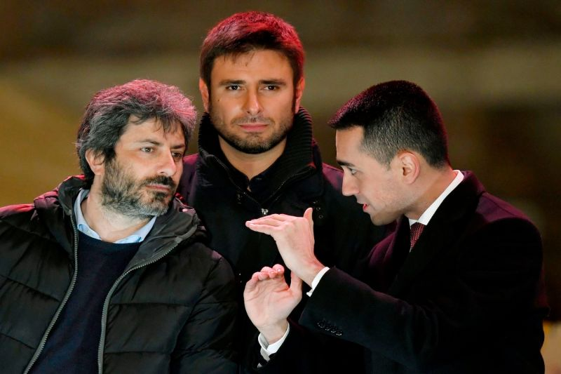 Italy's populist Five Star Movement leader Luigi Di Maio (R) with party members Roberto Fico (L) and Alessandro Di Battista (C) after an election campaign meeting in Piazza del Popolo in Rome on March 2, 2018.