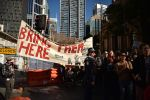Demonstrators march in Sydney during a protest to demand humane treatment of asylum-seekers and refugees on July 21. (Peter Parks/AFP/Getty Images)