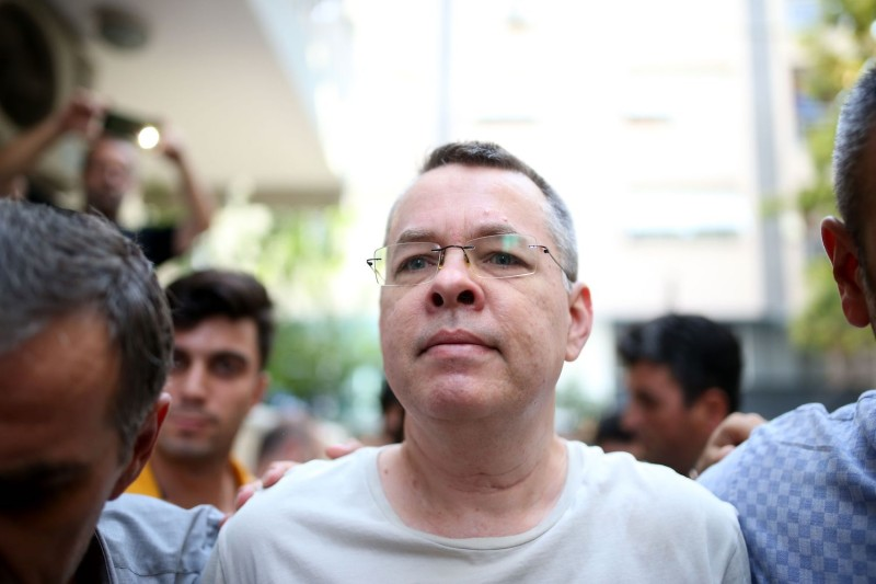 The Rev. Andrew Brunson, escorted by Turkish plainclothes police officers, arrives at his house in Izmir on July 25. (Stringer/AFP/Getty Images)