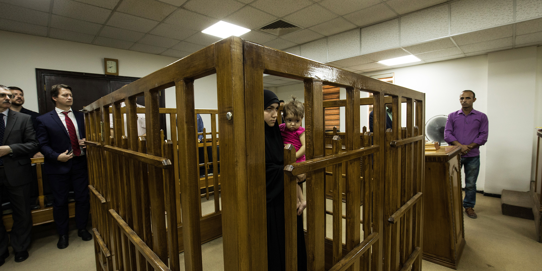 An arrested woman appears before Iraqi judges in a makeshift courtroom in Baghdad on April 17. (Afshin Ismaeli/SOPA Images/LightRocket via Getty Images)