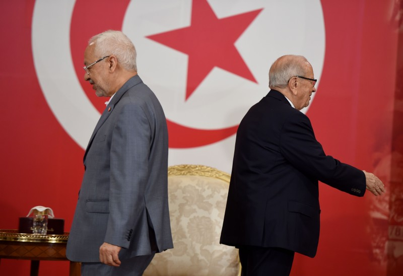 Tunisian President Beji Caid Essebsi and Rached Ghannouchi, prior to signing documents outlining the roadmap for the formation of a national unity government in Tunisia in Carthage near Tunis on July 13, 2016. (FETHI BELAID/AFP/Getty Images)