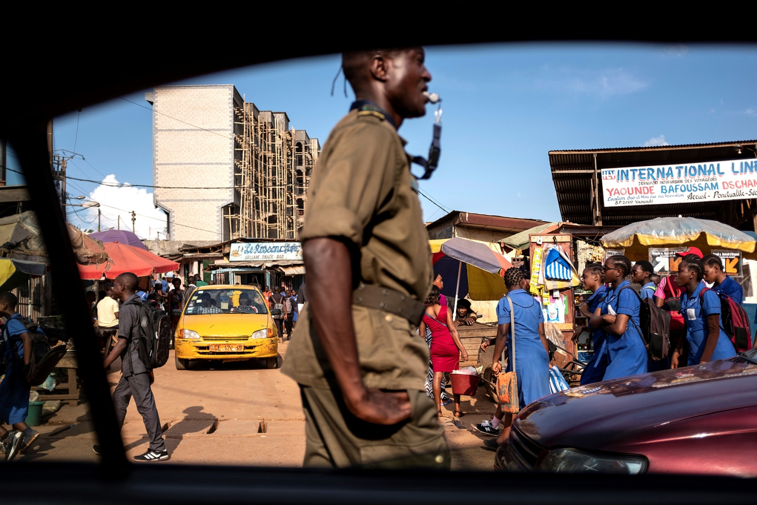 An officer directs traffic at a market in Yaounde, Cameroon, on Oct. 1. MARCO LONGARI/AFP/Getty Images