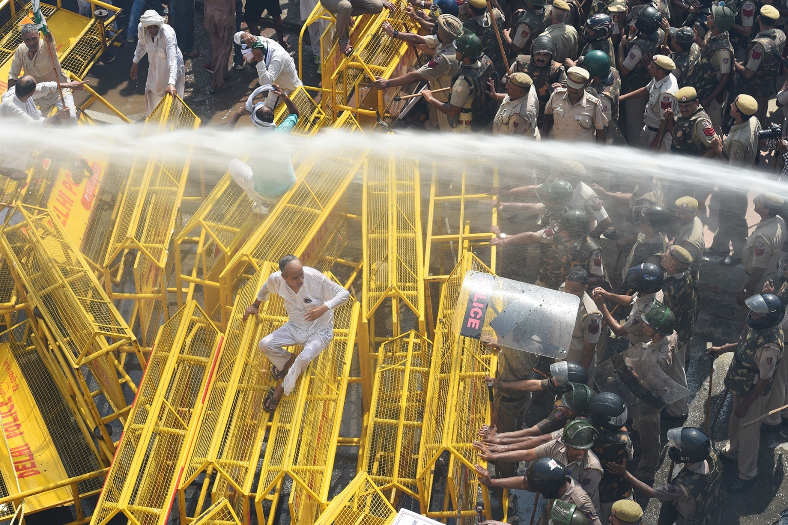 New Delhi police use water cannons to disperse and stop farmer activists of the Bhartiya Kisan Union at the border with Ghazipur during their march to New Delhi on Oct. 2. PRAKASH SINGH/AFP/Getty Images