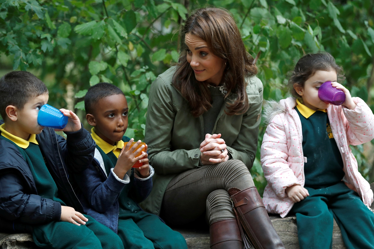 Britain's Catherine, Duchess of Cambridge, sits with schoolchildren during her visit to Sayers Croft Forest School and Wildlife Garden in London on Oct. 2. PETER NICHOLLS/AFP/Getty Images