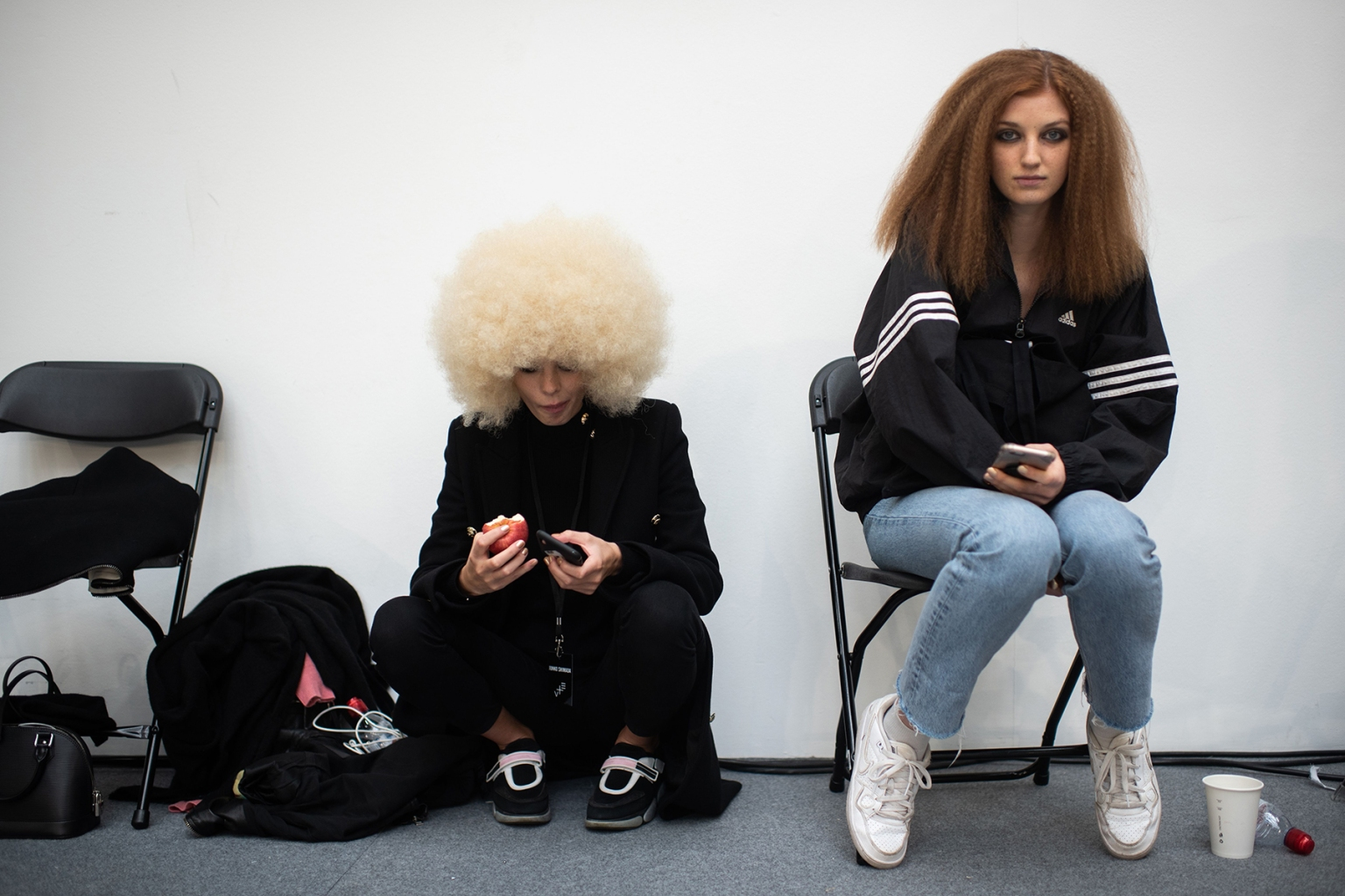 Models wait backstage prior to the Junko Shimada Spring-Summer Ready-to-Wear collection fashion show in Paris on Oct. 2. -/AFP/Getty Images