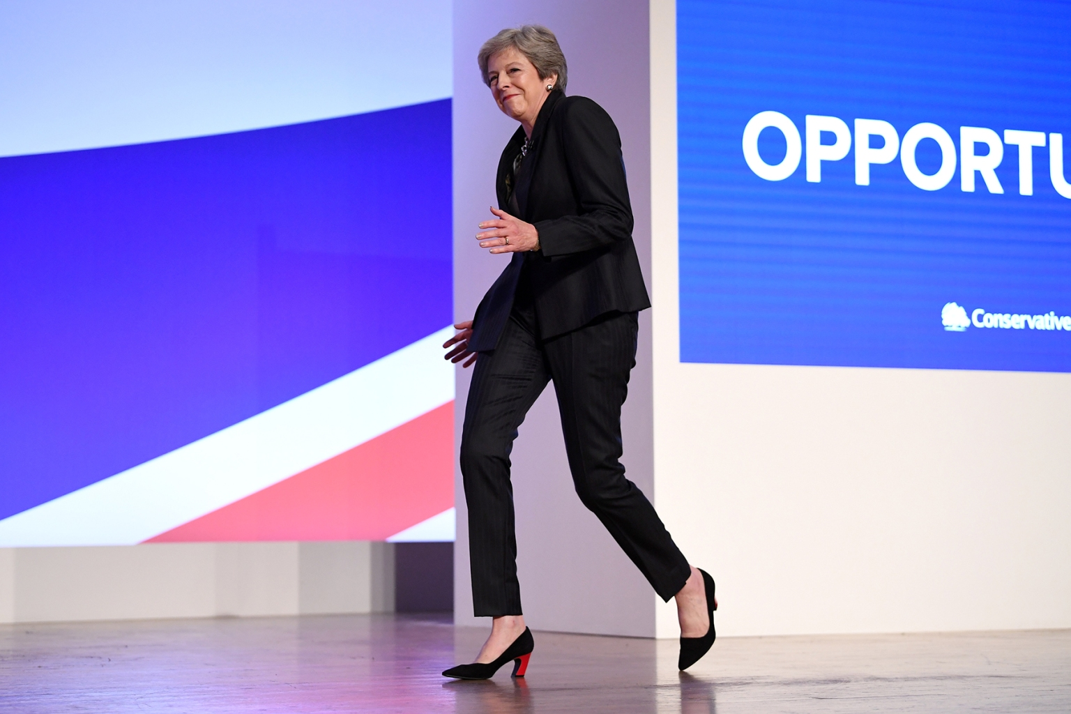 British Prime Minister Theresa May dances as she walks out onto the stage to deliver her leader's speech during the final day of the Conservative Party Conference in Birmingham, England, on Oct. 3. Jeff J Mitchell/Getty Images