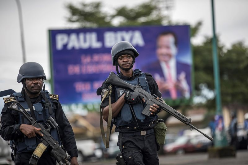 Members of the Cameroonian Gendarmerie patrol in Omar Bongo Square in Buea, Cameroon's majority-Anglophone southwestern province's capital, during a political rally for incumbent President Paul Biya on Oct. 3. (Marco Longari/AFP/Getty Images)