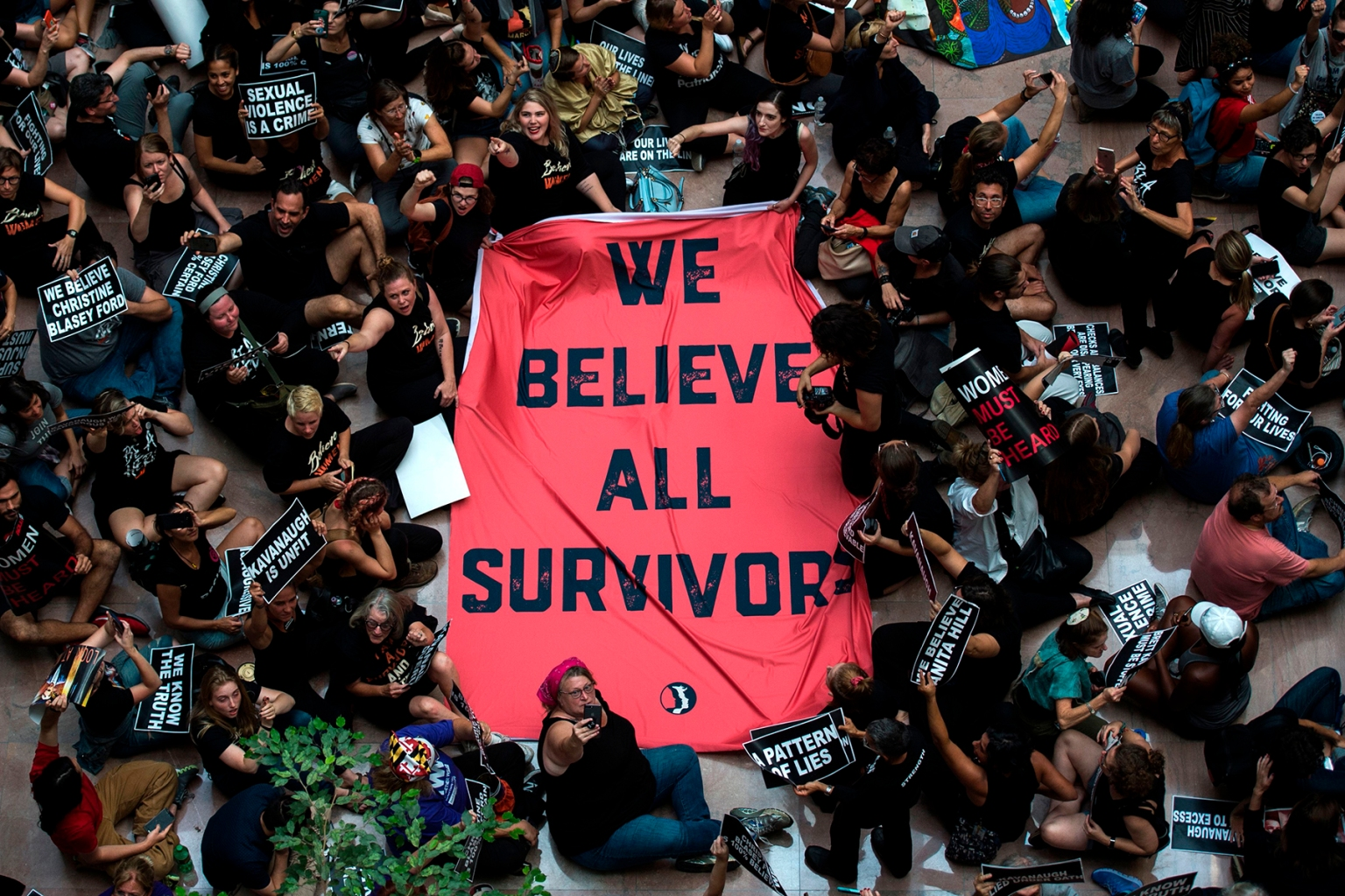 Protesters unfurl a sign as they occupy the Senate Hart building during a rally against Supreme Court nominee Brett Kavanaugh in Washington on Oct. 4. Andrew Caballero-Reynolds/AFP/Getty Images