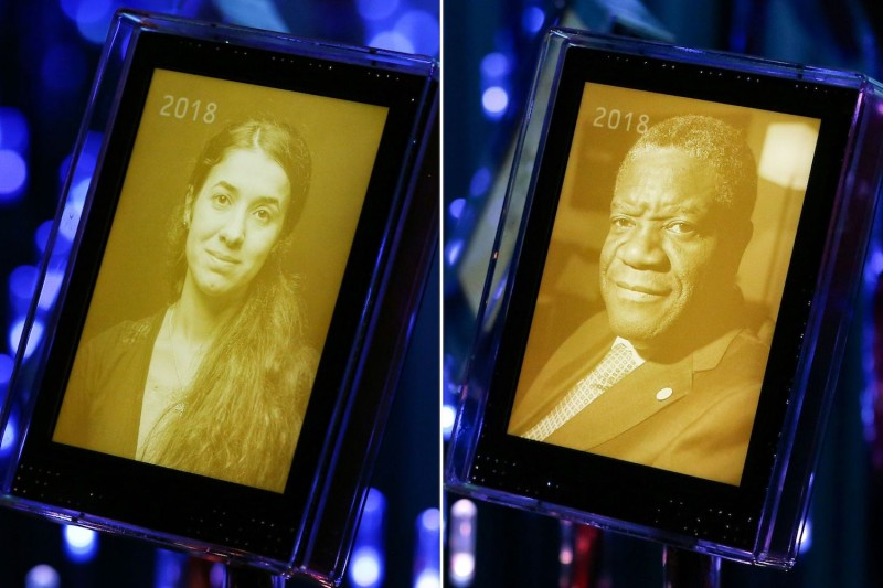Pictures of the 2018 Nobel Peace Prize winners, Nadia Murad, a public advocate for the Yazidi community in Iraq and a survivor of sexual violence, and Congolese doctor Denis Mukwege, displayed in Oslo on Oct. 5. (Fredrik Hagen /AFP/Getty Images)