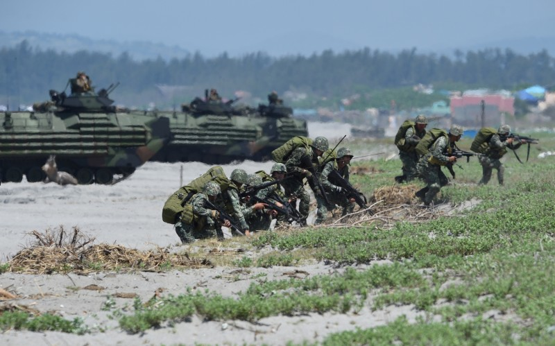 Japanese soldiers storm a beach in the Philippines on the South China Sea in joint military exercises with U.S. and Filipino troops on Oct. 6. (Ted Aljibe/AFP/Getty Images)