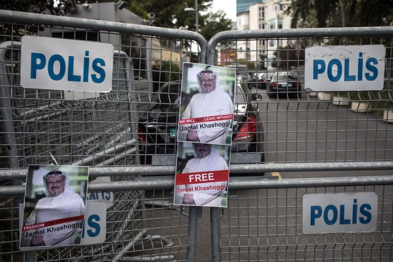 Posters advocating for Saudi journalist Jamal Khashoggi hang on a police barricade in front of  Saudi Arabia's consulate in Istanbul on Oct. 8. (Chris McGrath/Getty Images)