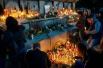 Bulgarians light candles during a vigil in memory of Bulgarian television journalist Viktoria Marinova in the city of Ruse on Oct. 8. (Photo by Dimitar Dilkoff /AFP/Getty Images)
