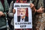 """A woman holds a portrait of missing journalist and Riyadh critic Jamal Khashoggi reading """"Jamal Khashoggi is missing since October 2"""" during a demonstration in front of the Saudi Arabian consulate on Oct. 9, 2018 in Istanbul. (OZAN KOSE/AFP/Getty Images)"""