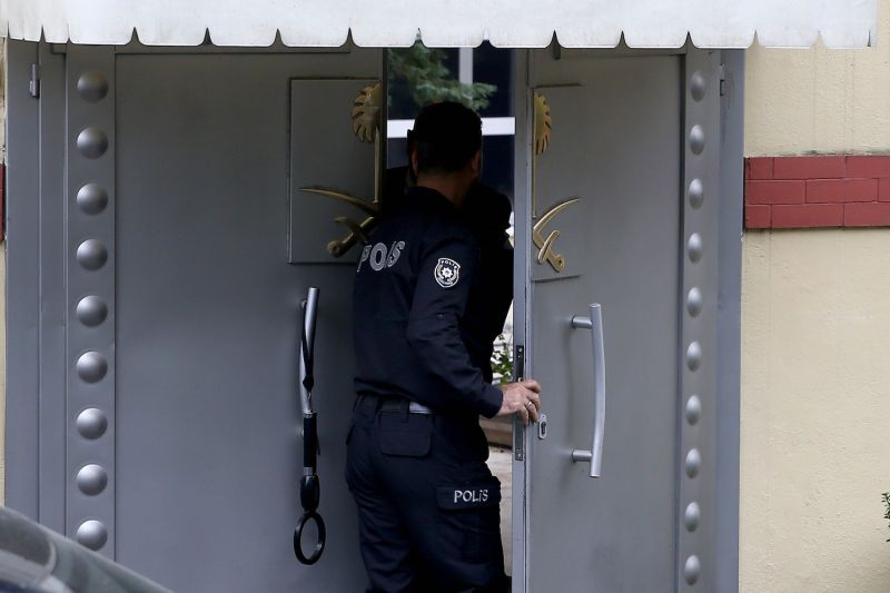 A police officer enters the Consulate General of Saudi Arabia in Istanbul, Turkey, as the search continues for Jamal Khashoggi, a journalist who has been missing since he entered the Saudi consulate in Istanbul on Oct. 2. (Onur Coban/Anadolu Agency/Getty Images)